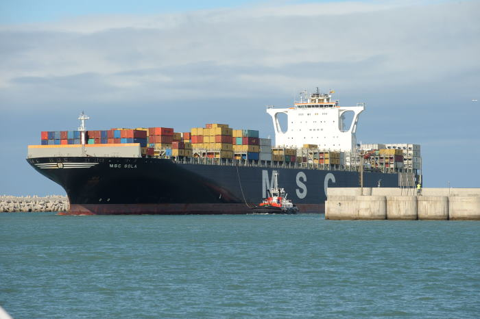 The tug joins the container vessel in the entrance channel of the Port of Ngqura